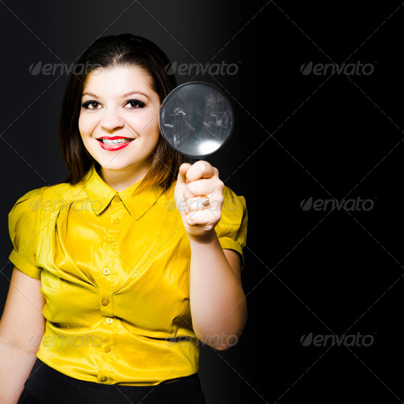 Woman with magnifier doing data recovery - Stock Photo - Images