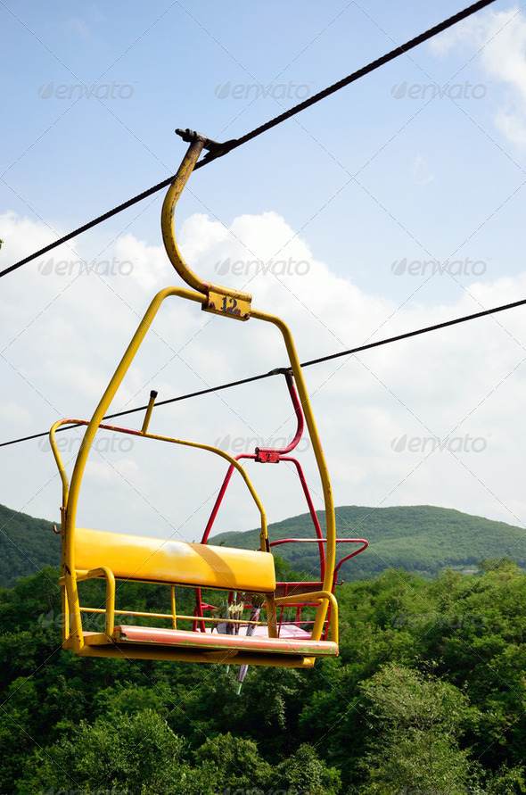 Cable car with nice sky anc forest background - Stock Photo - Images