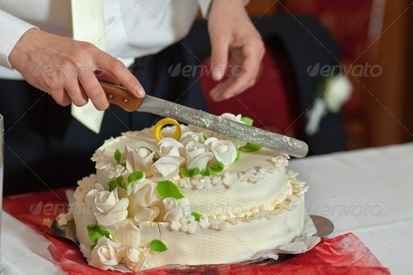 Cutting the wedding cake - Stock Photo - Images