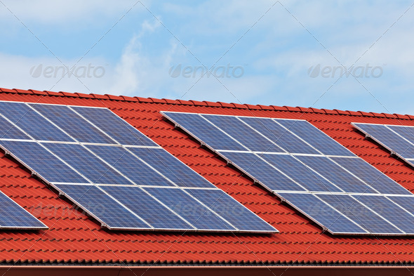 Solar panels on the roof of a row of houses - Stock Photo - Images