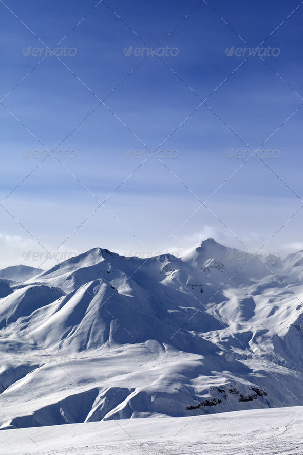 Snowy mountains and blue sky - Stock Photo - Images