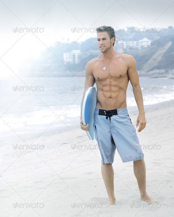 Serene surfer at the beach - Stock Photo - Images