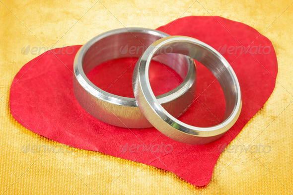 Wedding Rings On Paper Heart - Stock Photo - Images