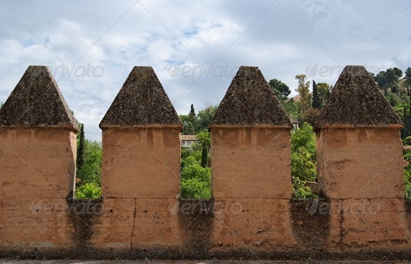 Wall crenellations in medieval castle in Spain - Stock Photo - Images