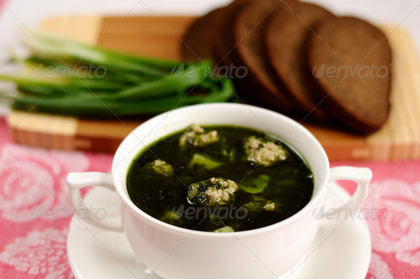 Spinach soup with meatballs - Stock Photo - Images