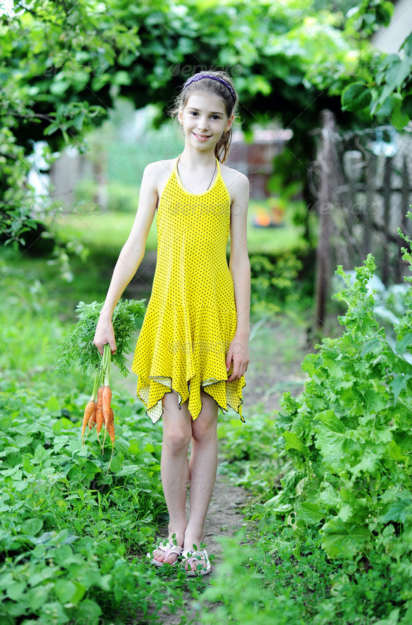 Girl with carrots - Stock Photo - Images
