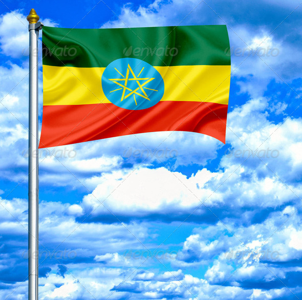 Ethiopia waving flag against blue sky - Stock Photo - Images