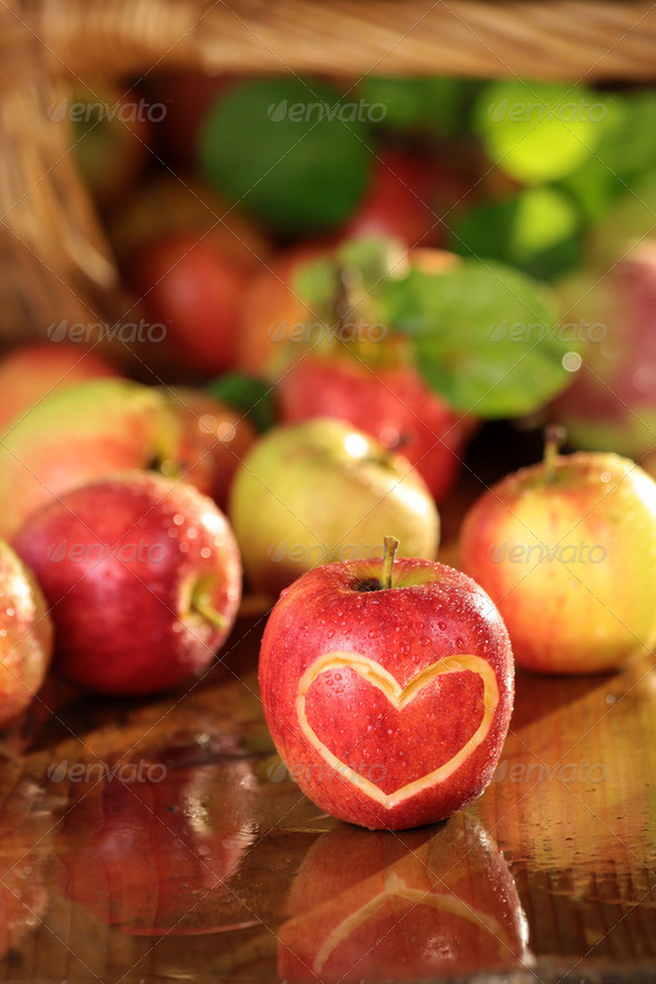 Basket of apples on a wet table - Stock Photo - Images