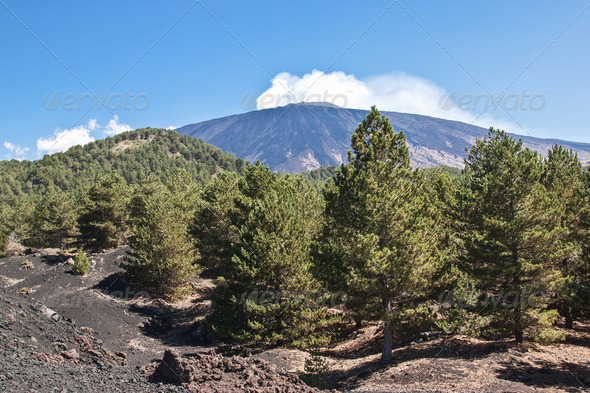 The volcano Etna landscape in a blue sky - Stock Photo - Images
