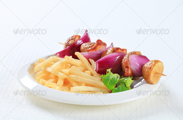 Bacon and potato skewer with fries - Stock Photo - Images