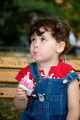 little girl is eating strawberry ice-cream - PhotoDune Item for Sale