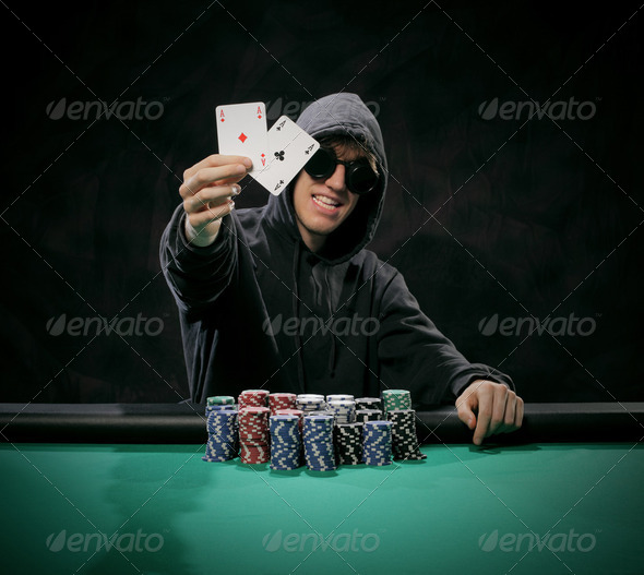 Portrait of a poker player - Stock Photo - Images