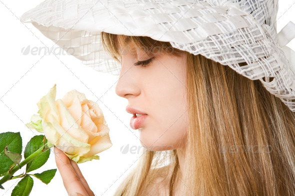 blonde woman with tea rose - Stock Photo - Images