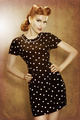 Pin-Up retro girl in classic fashion polka dots dress posing - PhotoDune Item for Sale