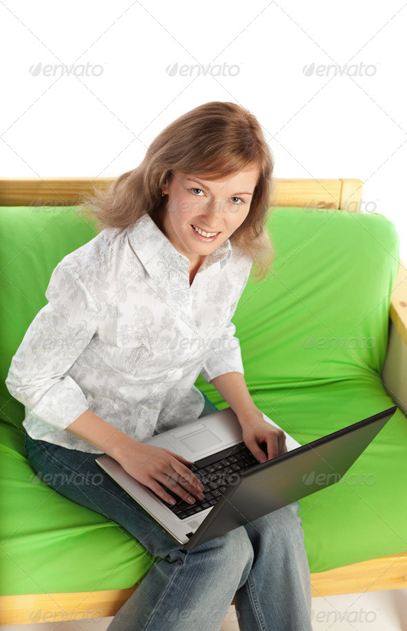 Young blond woman with computer - Stock Photo - Images