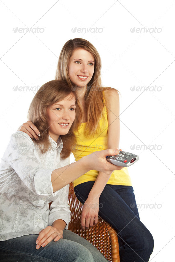 Young women watch TV - Stock Photo - Images