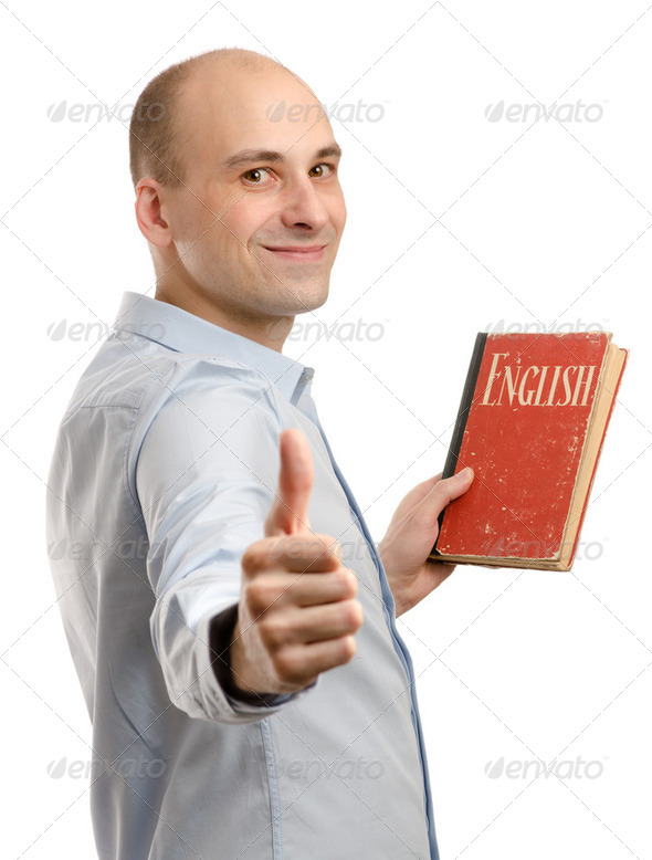young friendly man with English Dictionary Book - Stock Photo - Images