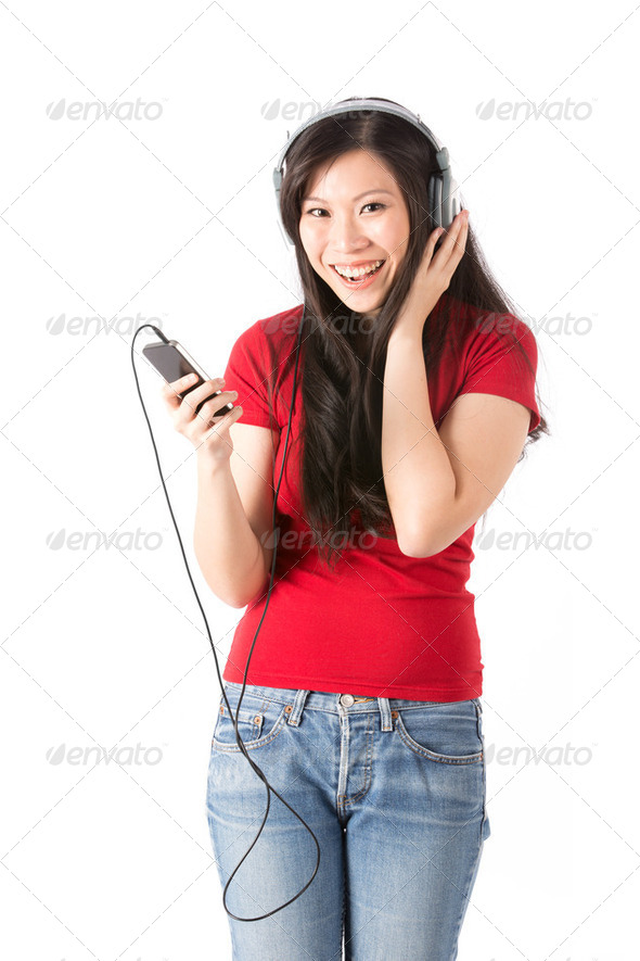 Happy Asian woman listening to Music - Stock Photo - Images