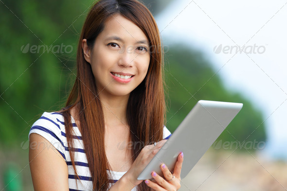 asian woman using tablet computer - Stock Photo - Images