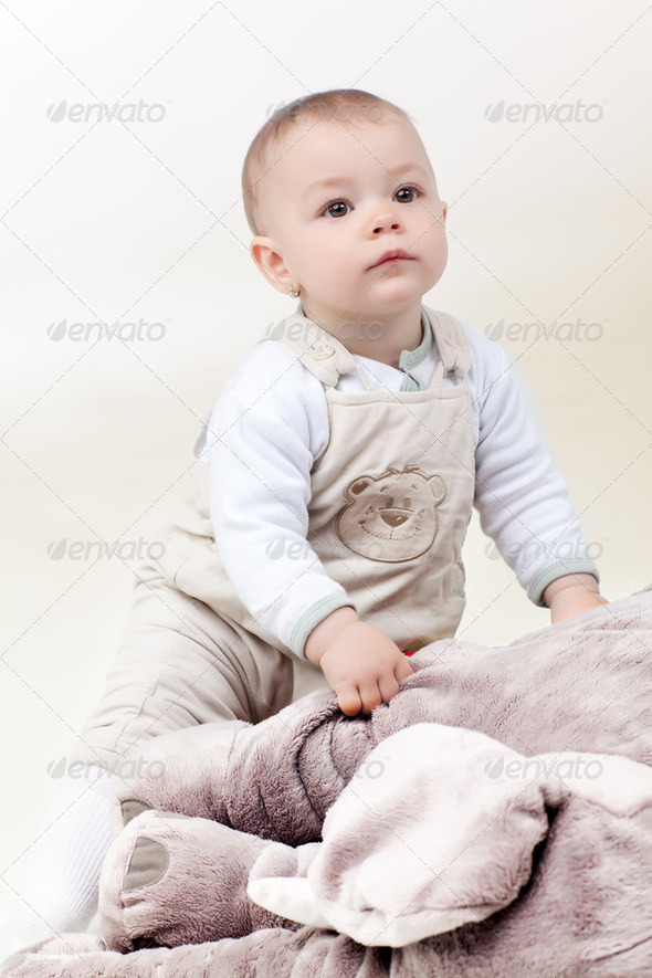 baby girl with toy - Stock Photo - Images