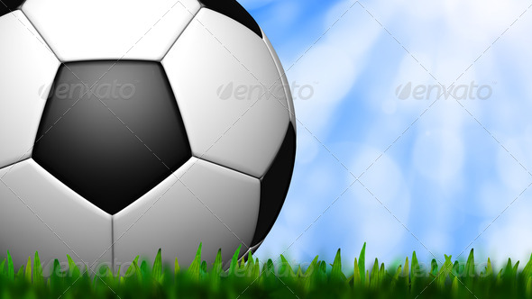 football in green grass over a sky - Stock Photo - Images