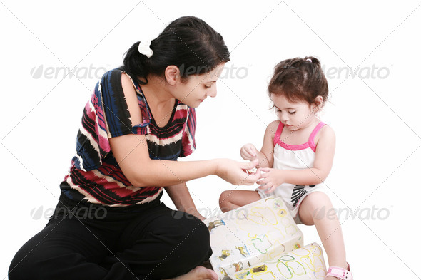 Beautiful little girl playing with her mother on the floor - Stock Photo - Images