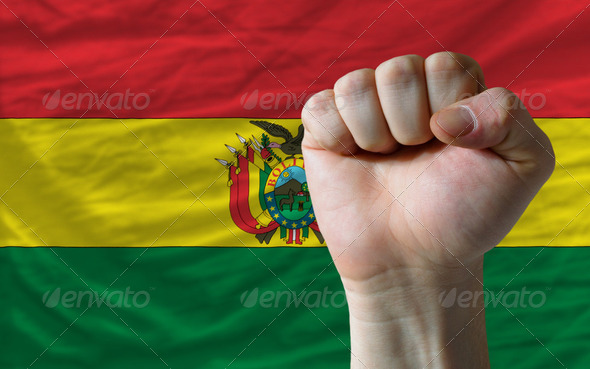 Hard fist in front of bolivia flag symbolizing power - Stock Photo - Images