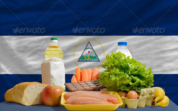 basic food groceries in front of nicaragua national flag - Stock Photo - Images