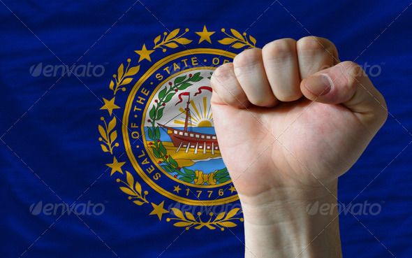 us state flag of new hampshire with hard fist in front of it sym - Stock Photo - Images
