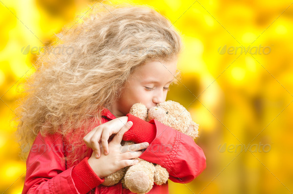 beautiful little girl with teddy bear - Stock Photo - Images