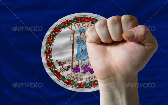 us state flag of virginia with hard fist in front of it symboliz - Stock Photo - Images