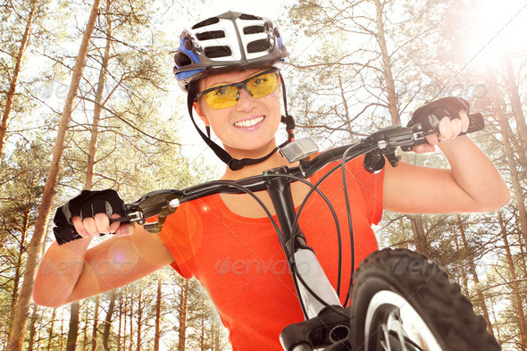 Cyclist in the woods - Stock Photo - Images