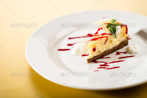 Delicious cheesecake with raspberry sauce - Stock Photo - Images
