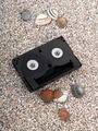 Hi-8 video tapes on beach - PhotoDune Item for Sale