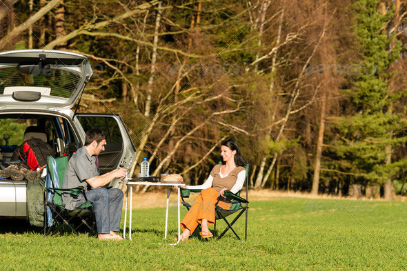 Camping car young couple enjoy picnic countryside - Stock Photo - Images