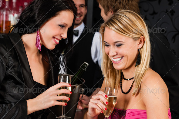 Happy girl friends with drinks enjoying party - Stock Photo - Images
