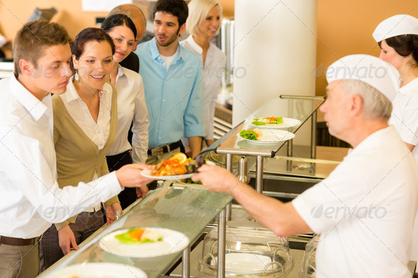 Office colleagues in canteen cook serve meals - Stock Photo - Images
