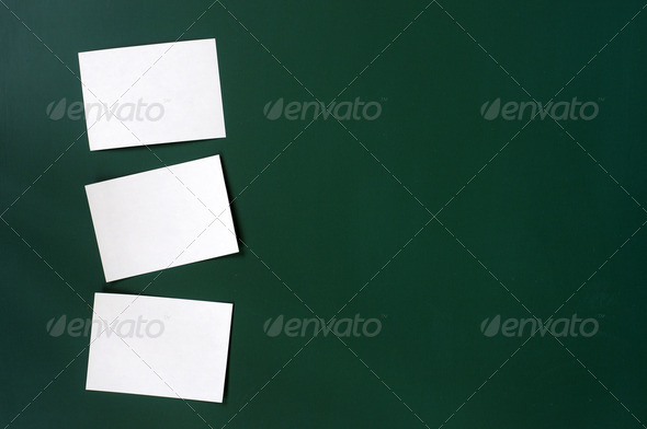 Blank stick note on a green board with copy space - Stock Photo - Images