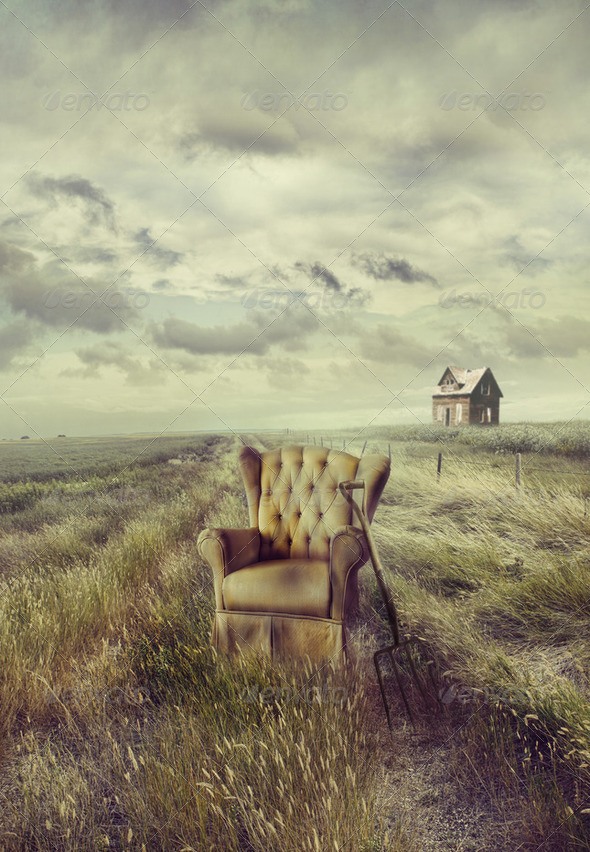 Old sofa chair in tall grass on prairie path - Stock Photo - Images