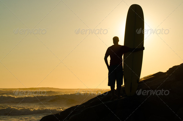 Long boarder watching the waves - Stock Photo - Images