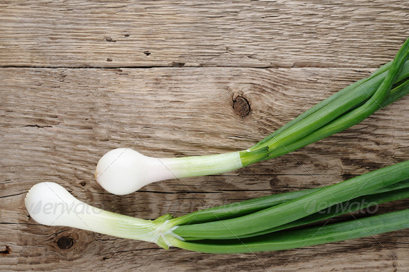 Green onion on wooden background - Stock Photo - Images
