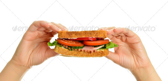Woman&#x27;s hands holding a sandwich, isolated on white - Stock Photo - Images