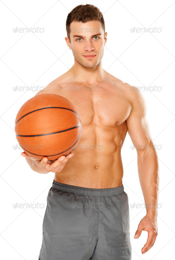 Handsome basketball player holding ball on white - Stock Photo - Images