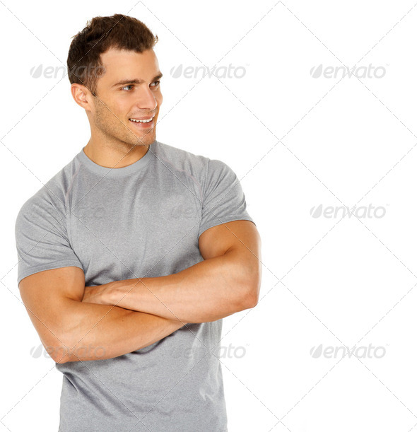 Handsome man with arms crossed looking his left on white - Stock Photo - Images