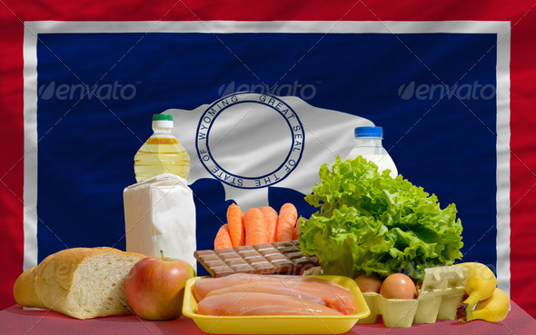 basic food groceries in front of wyoming us state flag - Stock Photo - Images