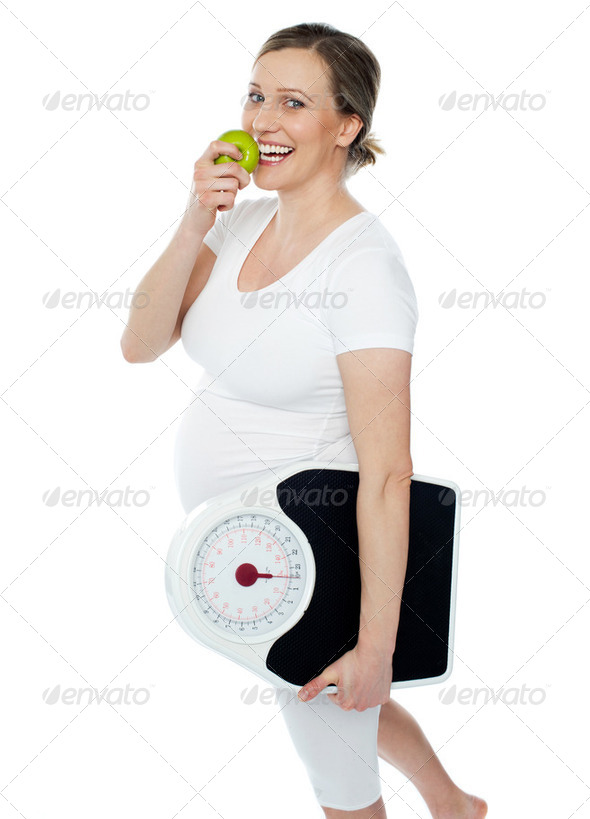 Young pregnant woman enjoy fresh green apple - Stock Photo - Images