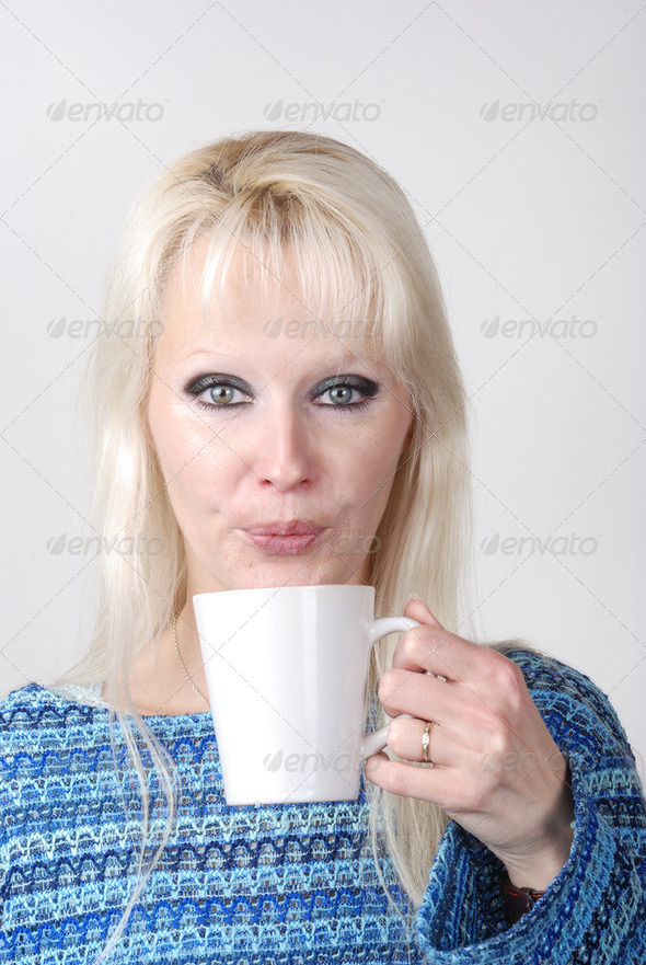 Woman drinking a hot drink - Stock Photo - Images
