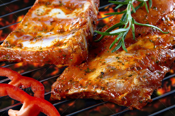 raw pork ribs on grill - Stock Photo - Images