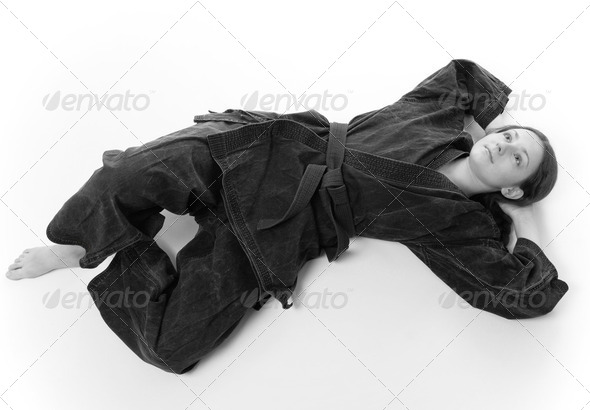 Girl lying in black uniform - Stock Photo - Images