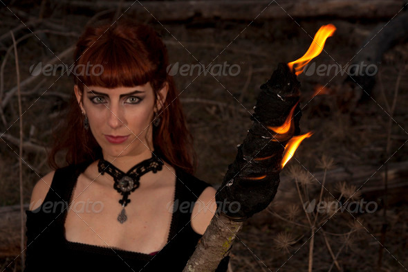 dark woman with torch - Stock Photo - Images